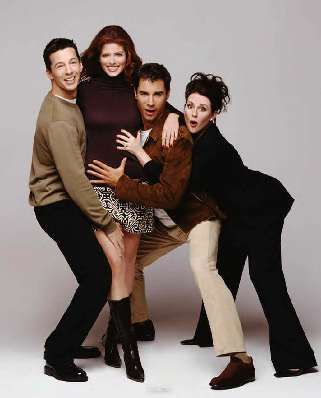 By 1999, Will & Grace had established itself as a breakout hit. It would win umpteen Emmys, and change hearts and minds, through 2006. (L-R) Sean Hayes, Debra Messing, Erik McCormack, Megan Mullally.