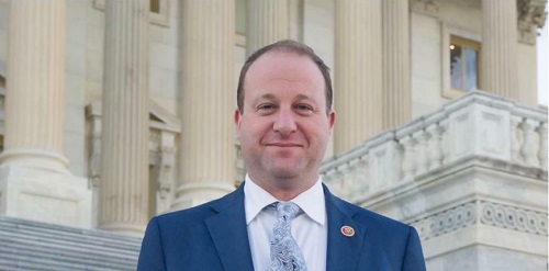 Polis becomes 1st Democrat to address conservative summit